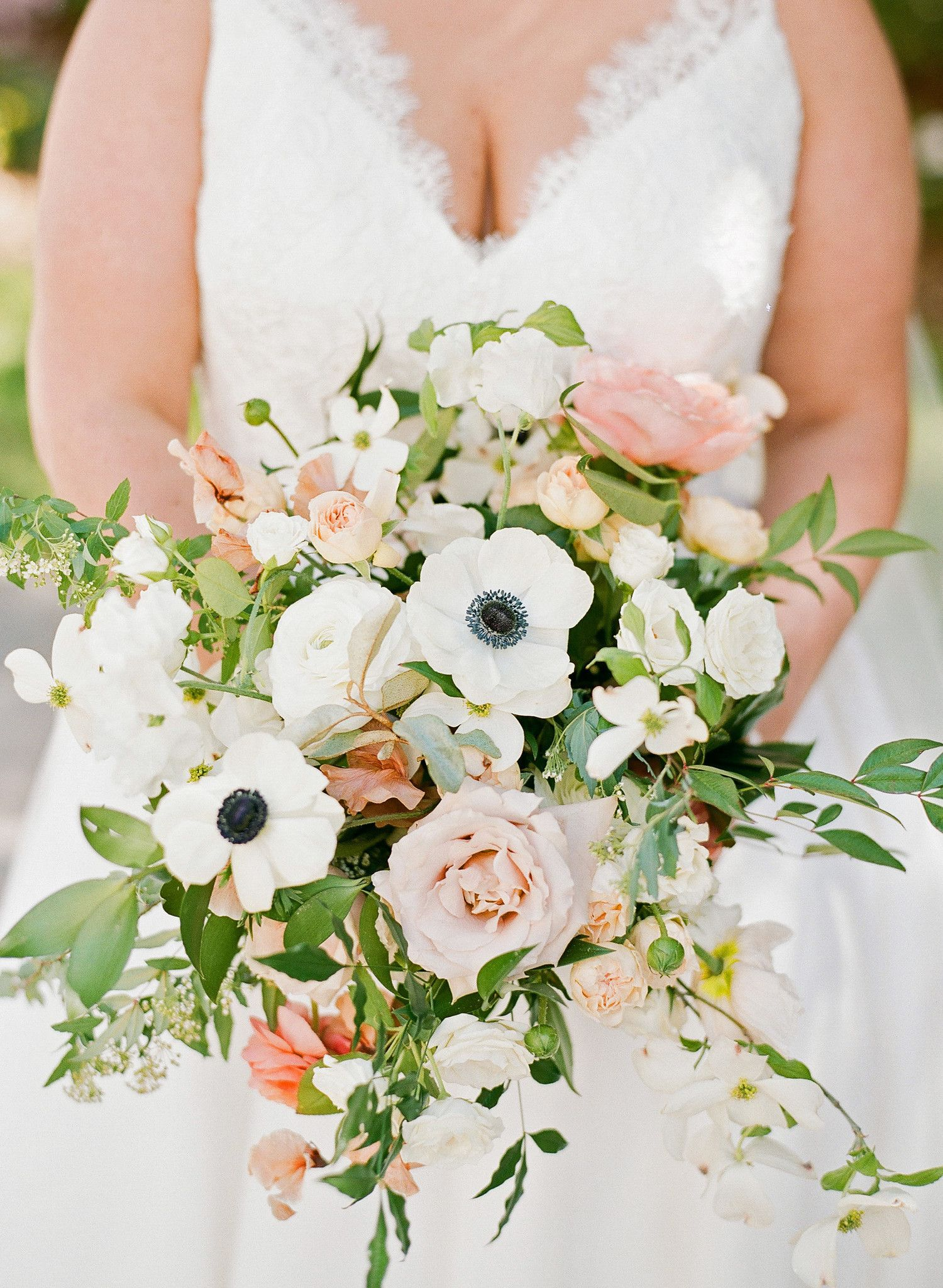 52 ideas for your spring wedding bouquet orange pink ranunculus this bride carried a bountiful bouquet of anemones roses dogwood sweet peas izmirmasajfo