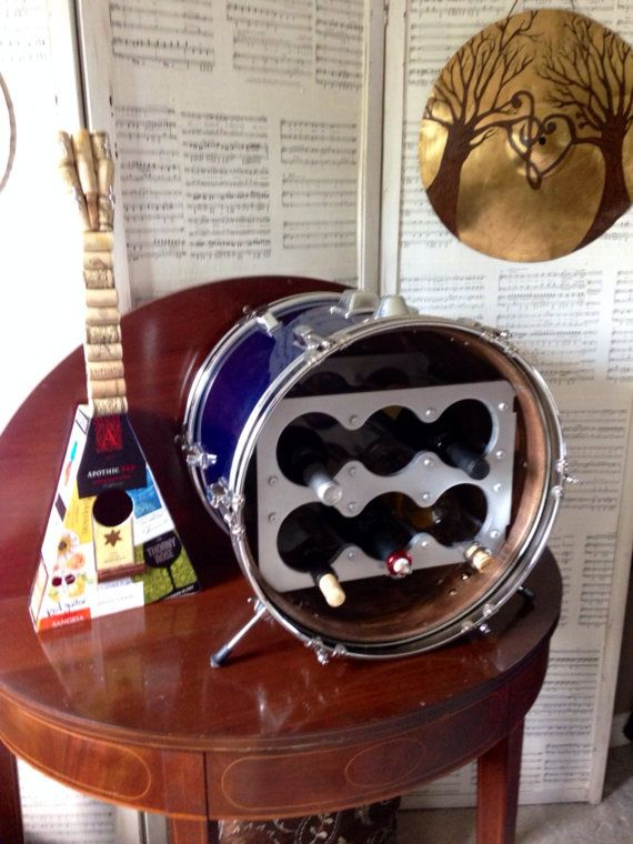 Bass drum wine storage a cool way to store your vino for Repurposed drum shelf