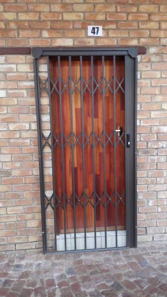 Security Gate For Your Back Door At Robo Door We Are Serious About Your Security Choose One Of Our Retract Security Gates Metal Doors Design Door Gate Design