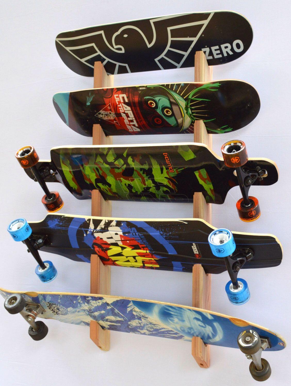Skateboard Longboard Wall Rack Mount -- Holds 5 boards by ProBoardRacks on Etsy https://www.etsy.com/listing/109927618/skateboard-longboard-wall-rack-mount