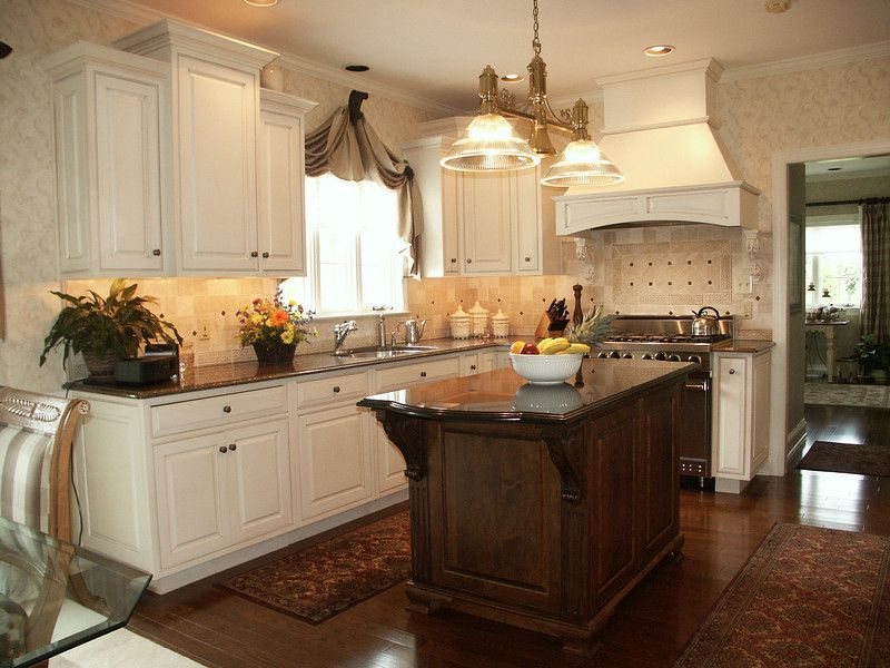 Antique white cabinets with glaze in antique white paint for French country white kitchen cabinets