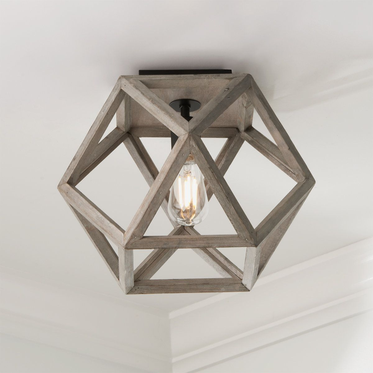 This weathered wood geometric ceiling light exudes laid-back modern style. Lightweight wood with a gray wash finish reminiscent of driftwood will brighten your space and blend right in with  your coastal, lodge or eclectic home. Character defining variation in the finish is to be expected with this natural wood piece.