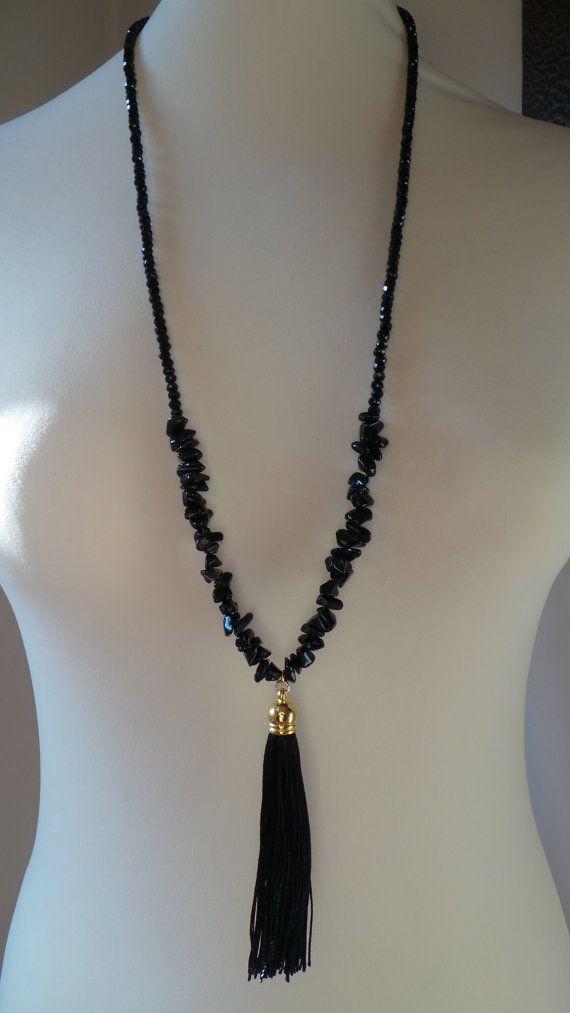 Black tassel necklace. Black tassel necklace with ...