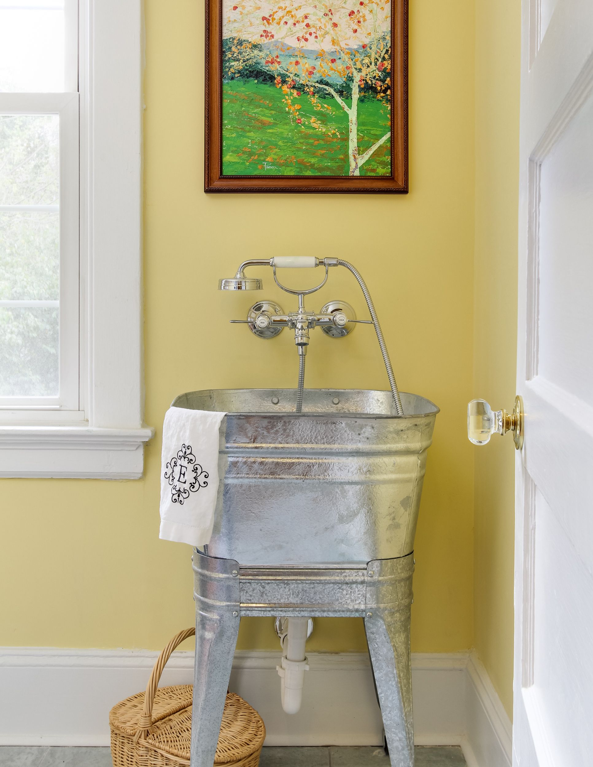 laundry room with vintage galvanized sink with a hansgrohe axor