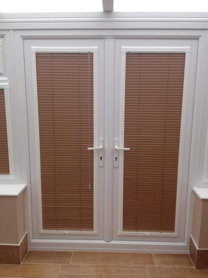A set of perfectfit venetian blinds in French doors by http://horizonblindsblackpool.co.uk/