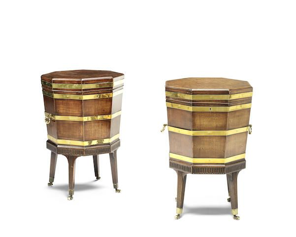 A pair of George III mahogany and brass bound cellarets on stands  (2)
