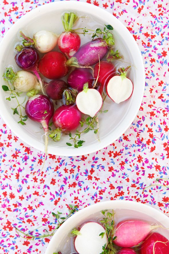 I serve garden radishes with a small white bowl of soft butter and another with sea salt.  Spread radish with butter  then dip in sea salt.  It's a fun little process and delish.