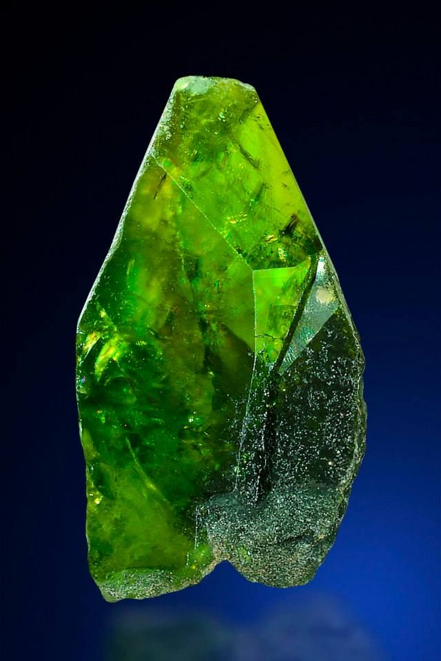 Titanite from Austria  Deep green Titanite crystals are very scarce, This large twinned single crystal comes from the Lienzinger peak area in Salzburg, Austria, a bowl-like hollow partially surrounded by cliffs or steep slopes at the head of a glaciated valley.