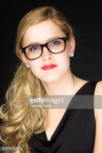 9d8c03511295 Bildbanksbilder   Pretty woman with red lipstick and blond hair wearing  glasses.
