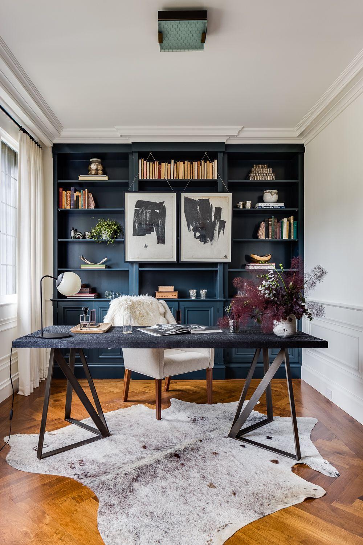 Home Office Library Kindesign White Walls, Natural Wood Floors, Dark Gray  Built In Shelves