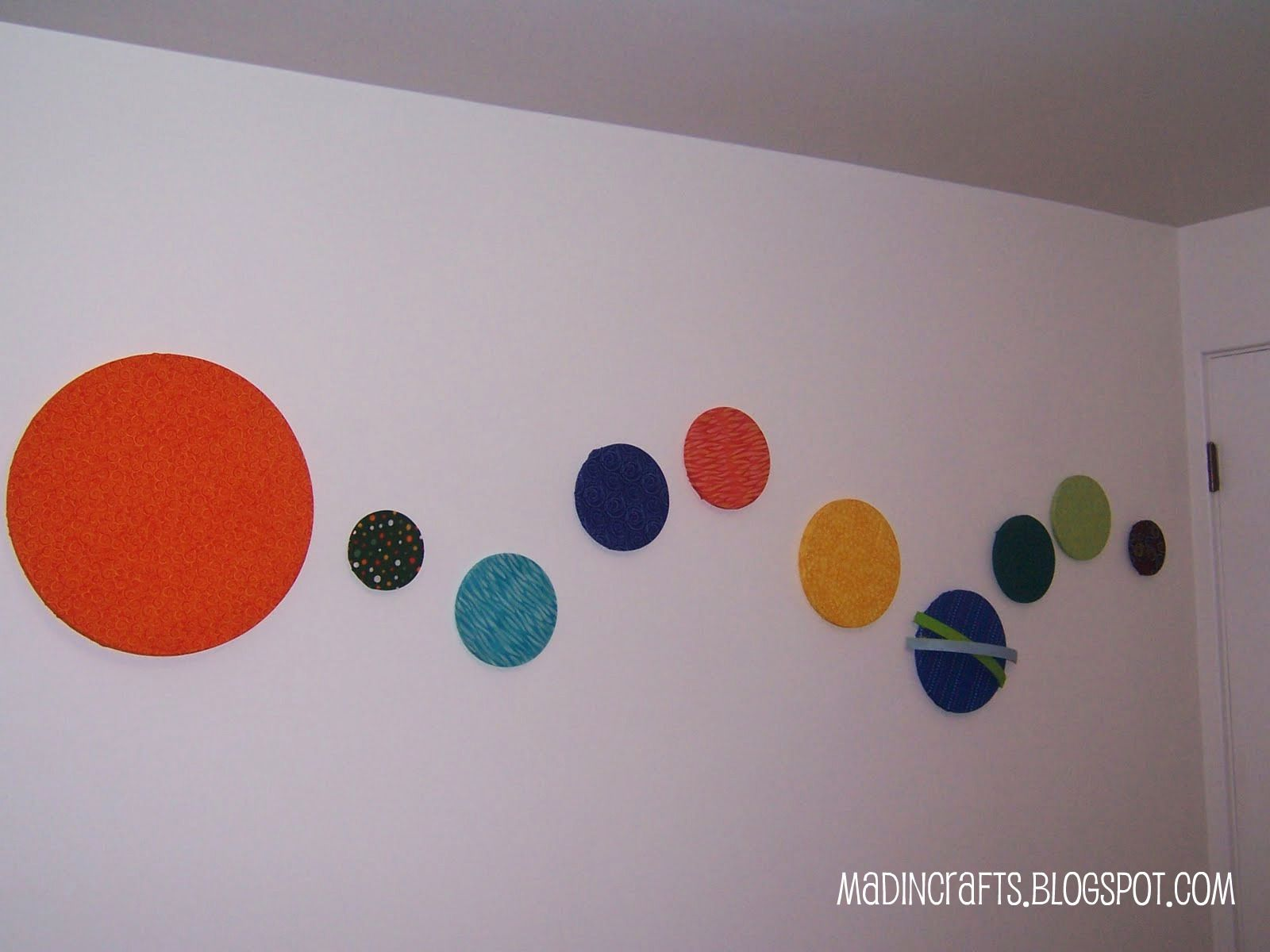 Since we are renting our home, we are not allowed to paint.  Huge bummer.  Especially since all the walls and molding are stark white.    In order to bring color into my son's space-themed room, I decided to use up some of that large wall space with an easy solar system.  I had originally seen …