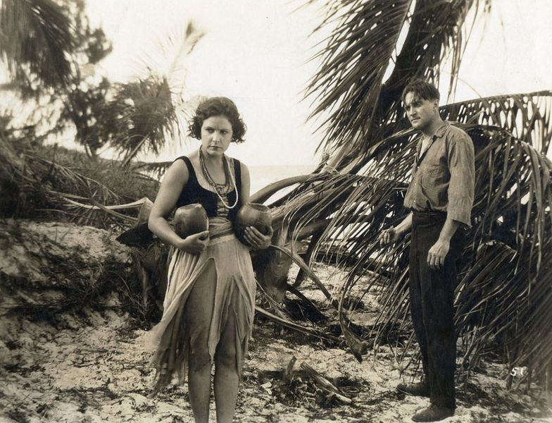 "Norma Talmadge and Wyndham Standing in ""The Isle of Conquest"" (1919)"