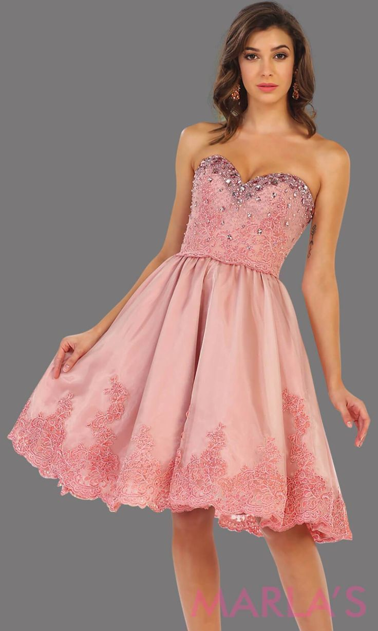 7476-Mid length pink strapless dress with lace detail and corset back. Perfect for grade 8 graduation dress, confirmation dress, wedding guest dress, sweet 16 dress, quinceanera, damas, or short pink prom dress. Available in plus sizes #graduationdress  #graddress #promdress #bridaldress  #showerdress #confirmationdresses 7476-Mid length pink strapless dress with lace detail and corset back. Perfect for grade 8 graduation dress, confirmation dress, wedding guest dress, sweet 16 dress, quinceaner #confirmationdresses