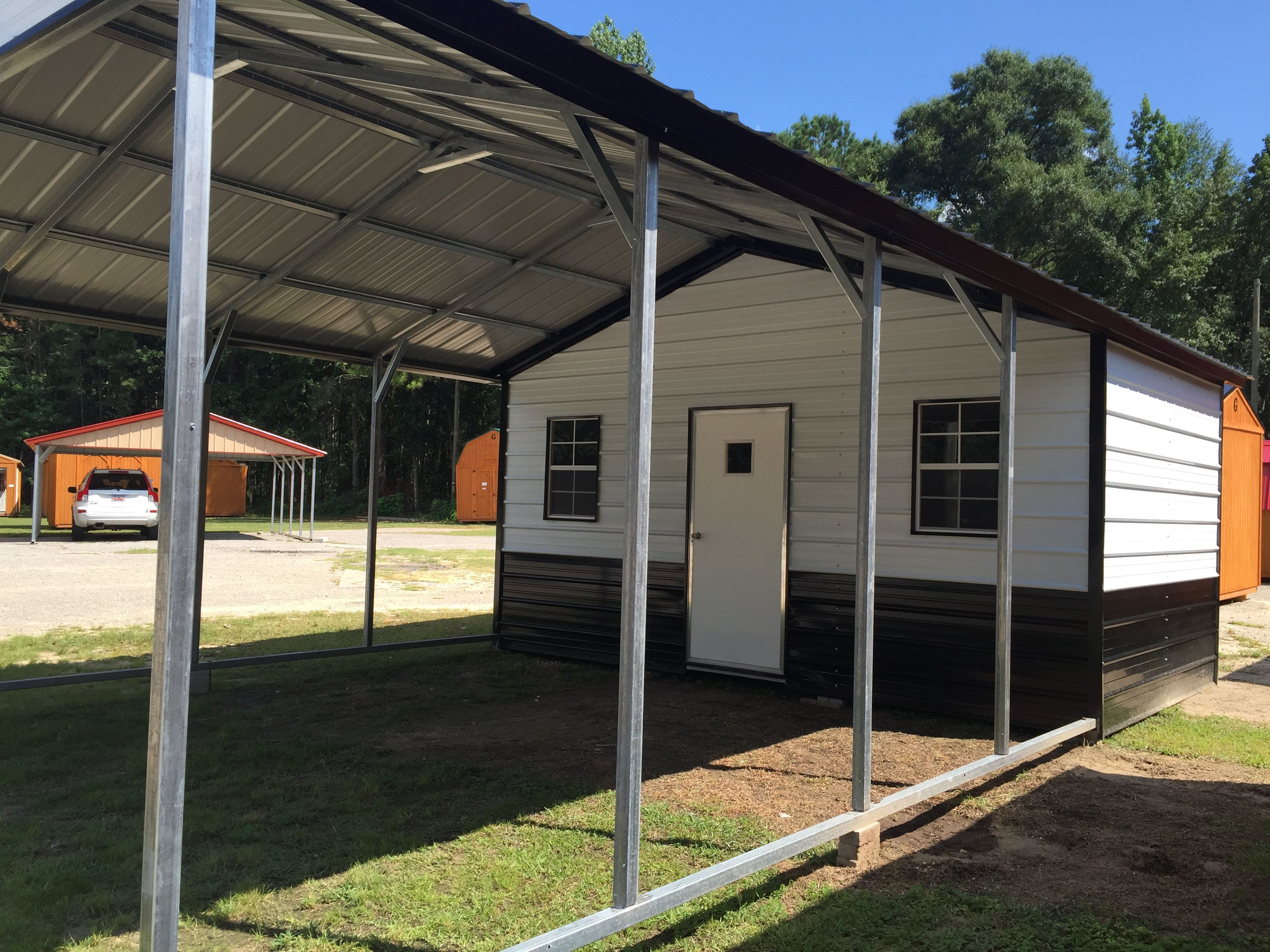 18x31 Carport And Storage Combo Visit Our Dealership For More Enclosed Metal Building Options Portable Carport Carport Metal Buildings