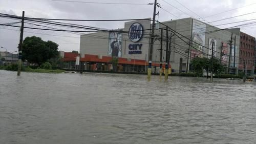 "Some of Cavite area are too low that's why it is really affected by floods during typhoons. More over most of the college students are really having a hard time to go to their Univ due to this calamity. This photo is the situation at Sm last ""Habagat"" days."