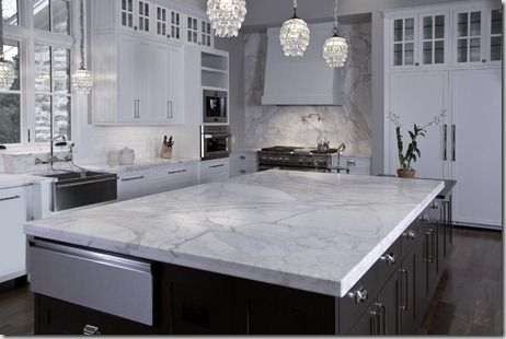 this kitchen has a beautiful dark wood island w/a marble top, 3 ... - kitchen counter marble