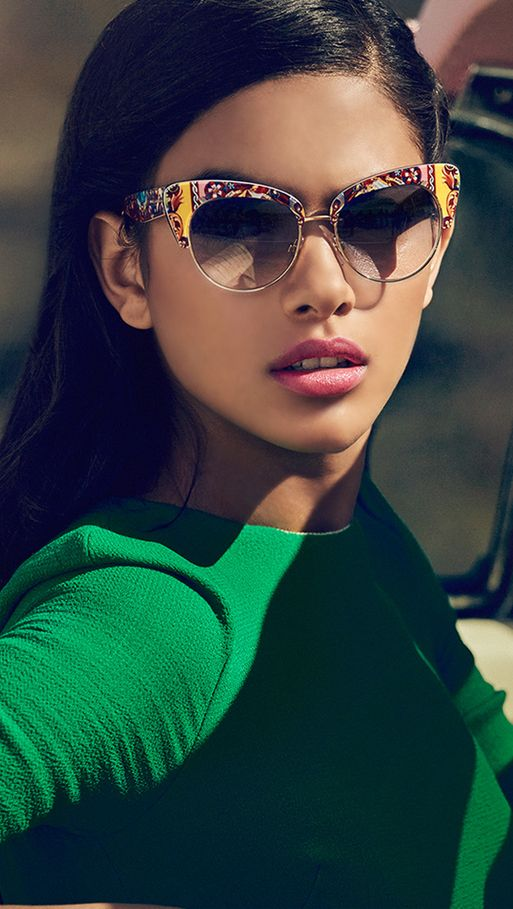 9e7d496121d1 The fashion-forward design features a half cat's eye frame and gradient  oval lenses.