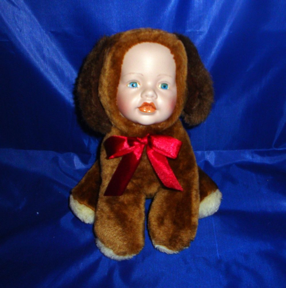 Show Stoppers Porcelain Baby Faced Brown Dog Doll Sitting 9 Inch NEW