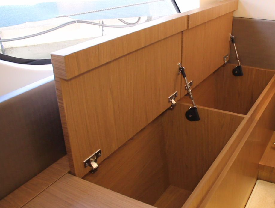 There is plenty of room in the solid woods storage trunks in the master stateroom on the GT 49 Fly.