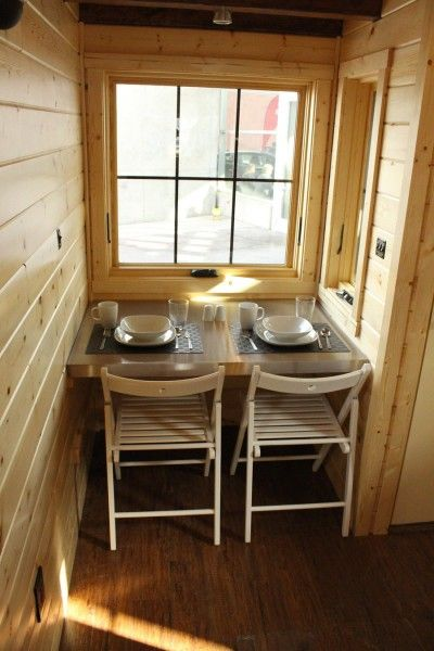 dining set up 400x600 cozy 165 square foot tiny house on a trailer - Tiny House Trailer Interior
