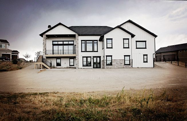 Modern rustic white farmhouse black doors black trim for Modern farmhouse windows
