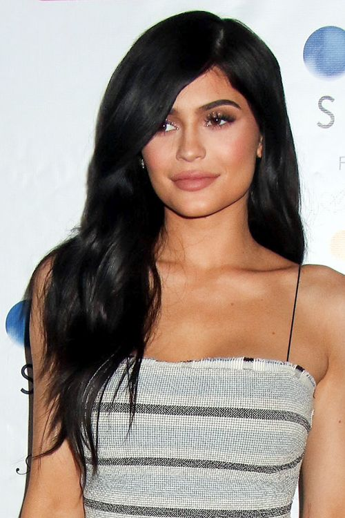 Kylie Jenner Wavy Black Long Layers, Side Part Hairstyle