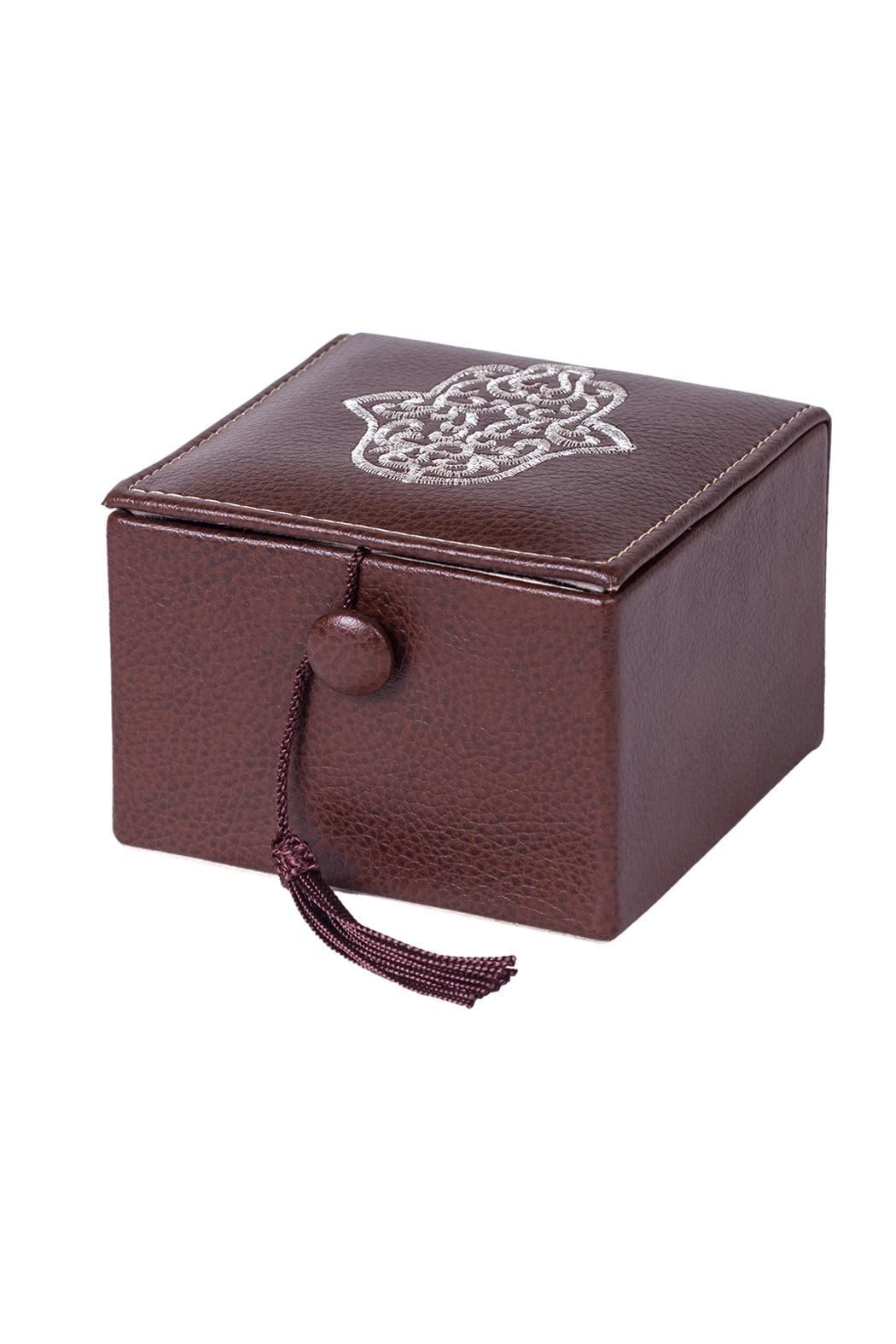 """Brown leather jewelry box with a hamsa embroidered top, lined interior and tassel tie closure.    Approx. Measures: 4"""" x 3"""" x 4"""".   Hamsa Jewelry Box  by Le Beau Maroc . Home & Gifts Florida"""