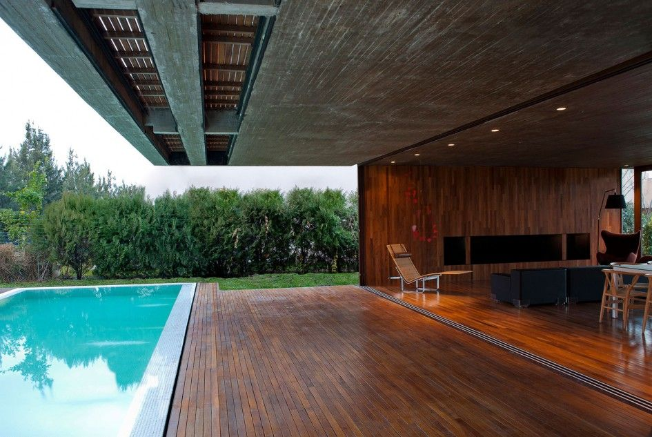 interior contemporary two story home interior design by fritz fritz arquitectos blue swimming pool in wooden floor with living room view - Swimming Pool Deck Design