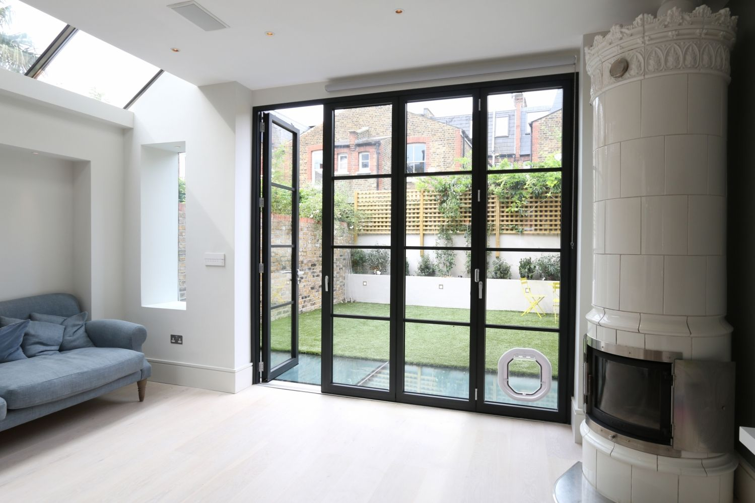 Incorporating A Dog Flap Into These Schuco Bifold Doors Also Gives