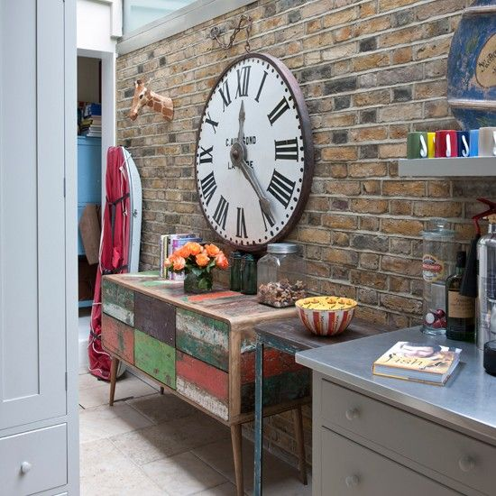 Beautiful A Distressed, Colourful Sideboard Complements This Exposed Brick Wall. The Large  Clock Adds Another