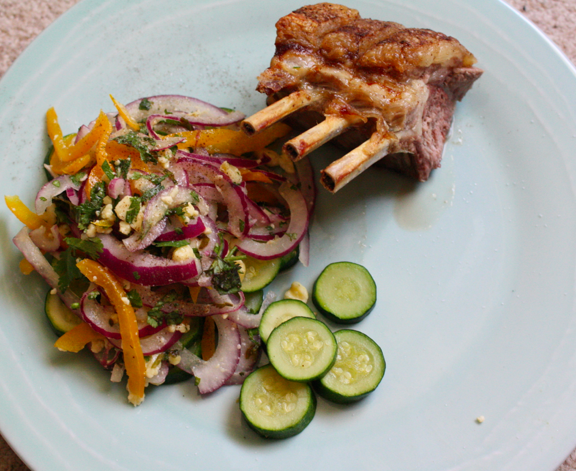 A crispy rack of lamb, served with a light and fresh salad with a burst of herbs and feta.