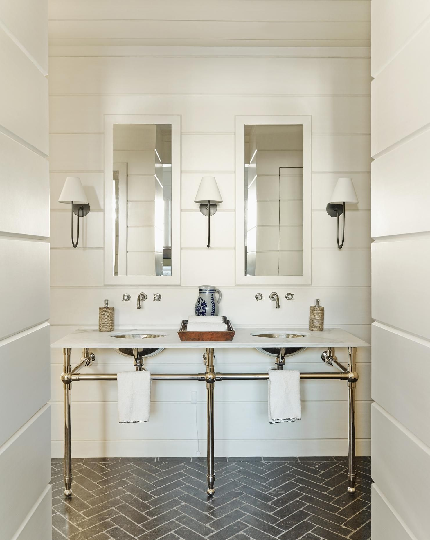 This Beautiful White Bathroom Boasts Shiplap Walls And Subway Tiles In  Chevron Pattern