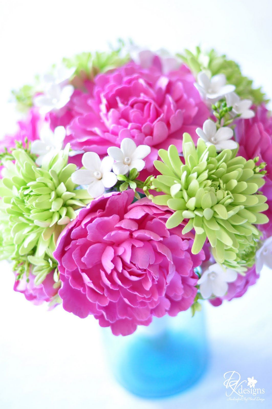 Pink peonies, green spider mums, and stephanotis flowers with pearl centers