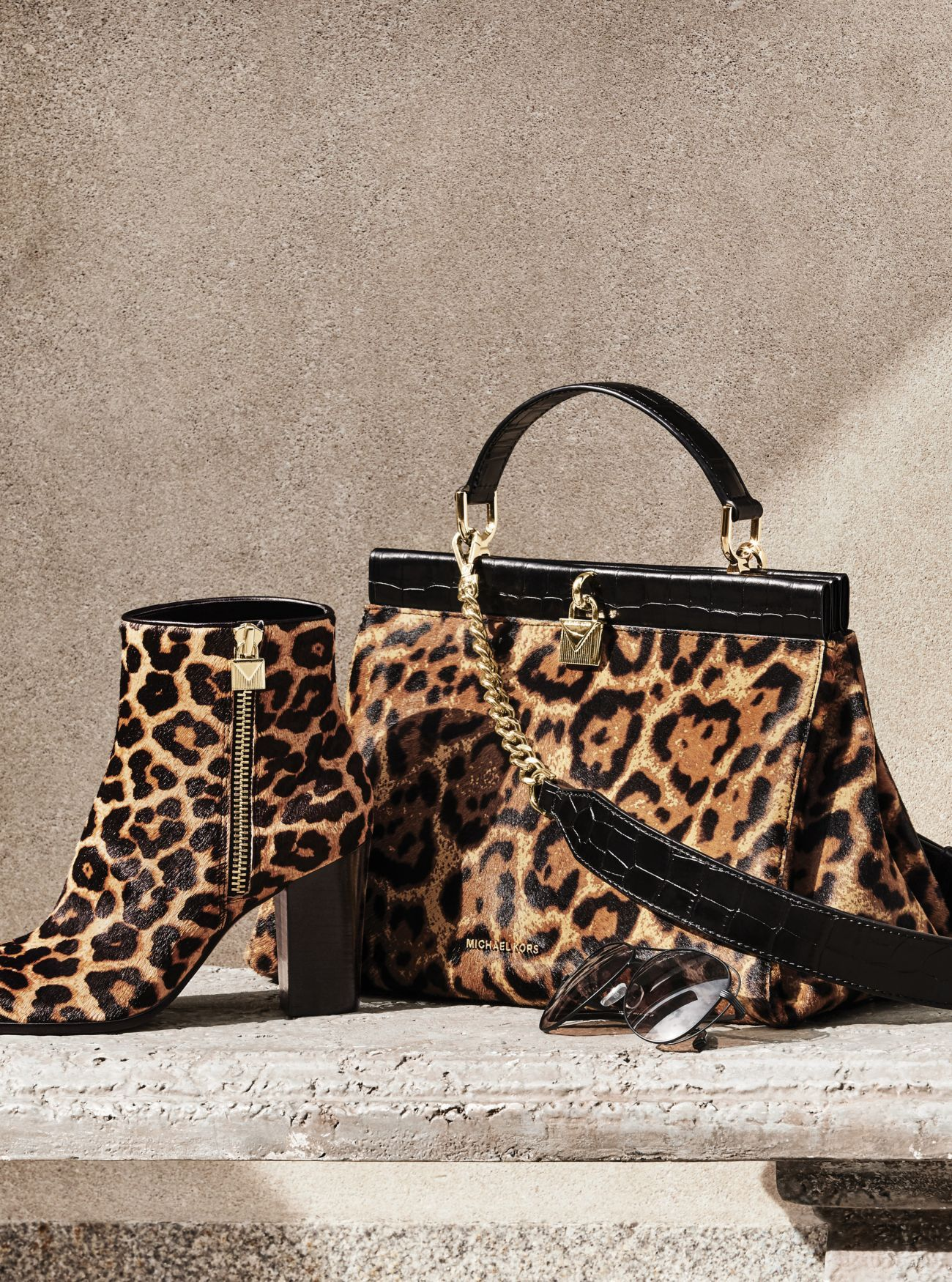 0e941d0c2edc Michael Kors Margaret Leopard Calf Hair Ankle Boot. Designed in richly  tactile