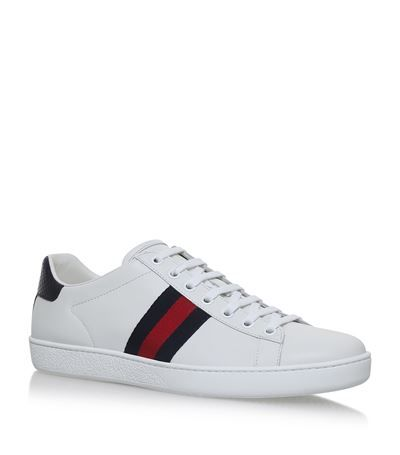 138a64b9045b Gucci New Ace Sneakers available to buy at Harrods. Shop Gucci shoes online  and earn Rewards points.