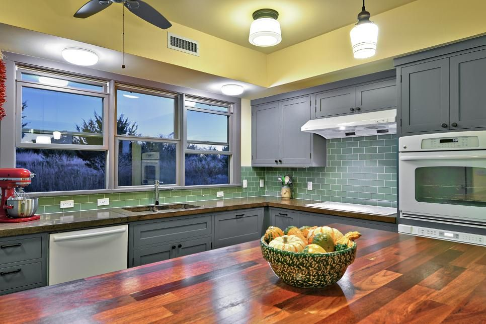 Kitchen Backsplash Yellow Walls cheerful yellow walls, dusty blue cabinets and a green subway tile