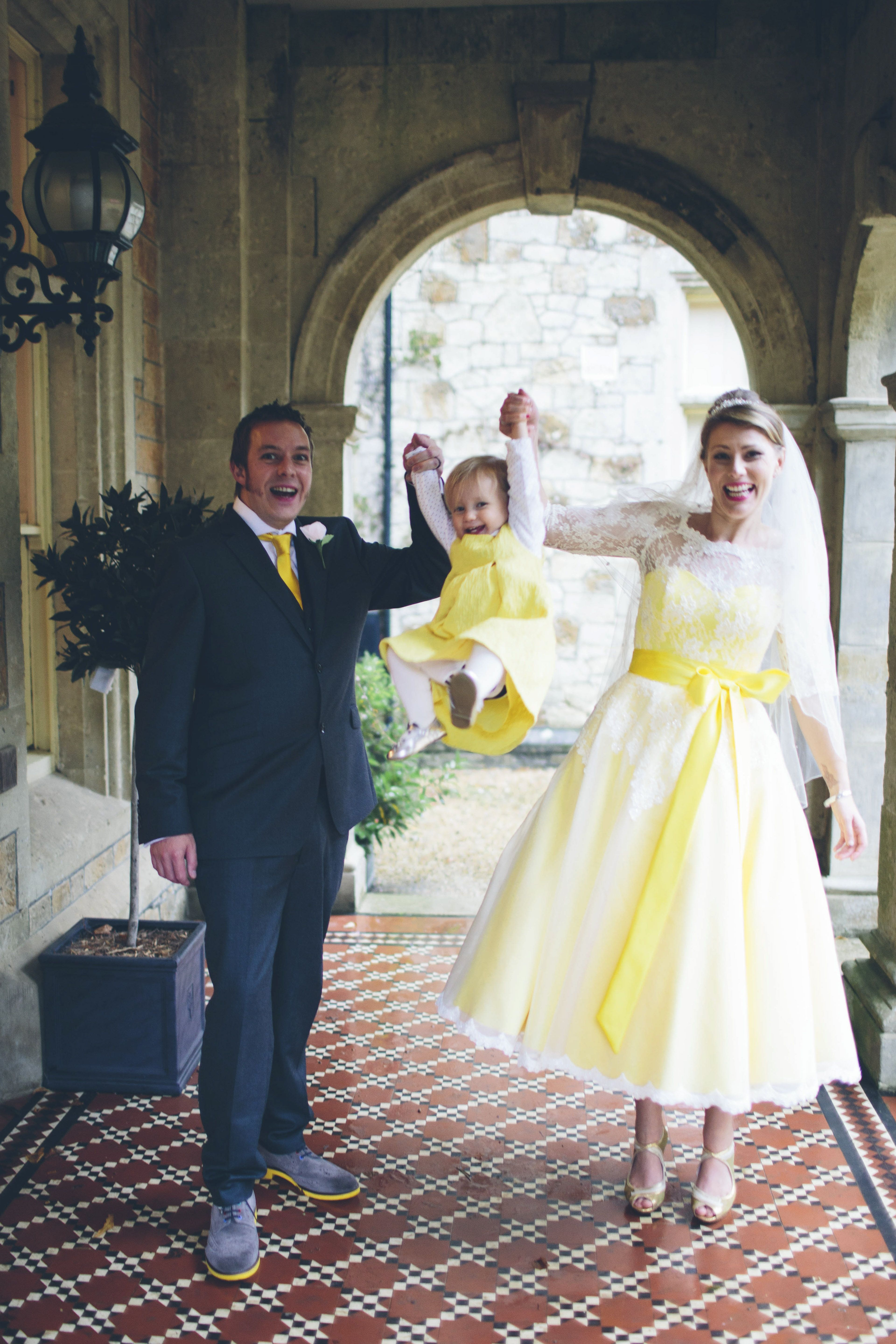 A bright and cheerful pin of a yellow francesca wedding gown to