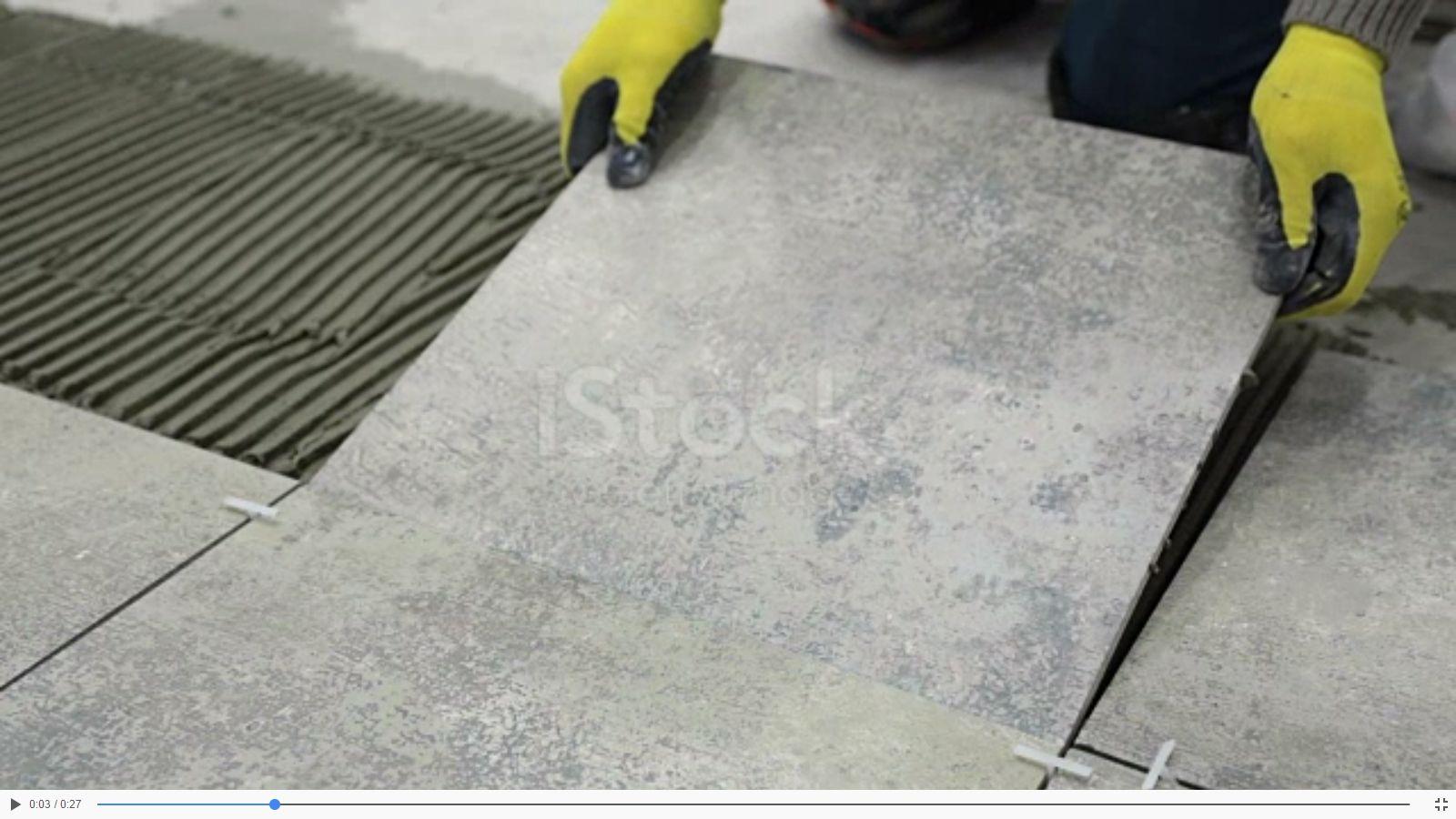 Construction worker installs and removes ceramic tile. | Ceramic ...