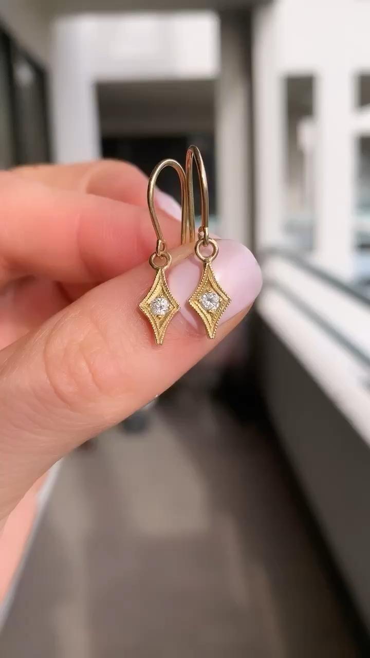Photo of Dainty gold delicate diamond drop earrings