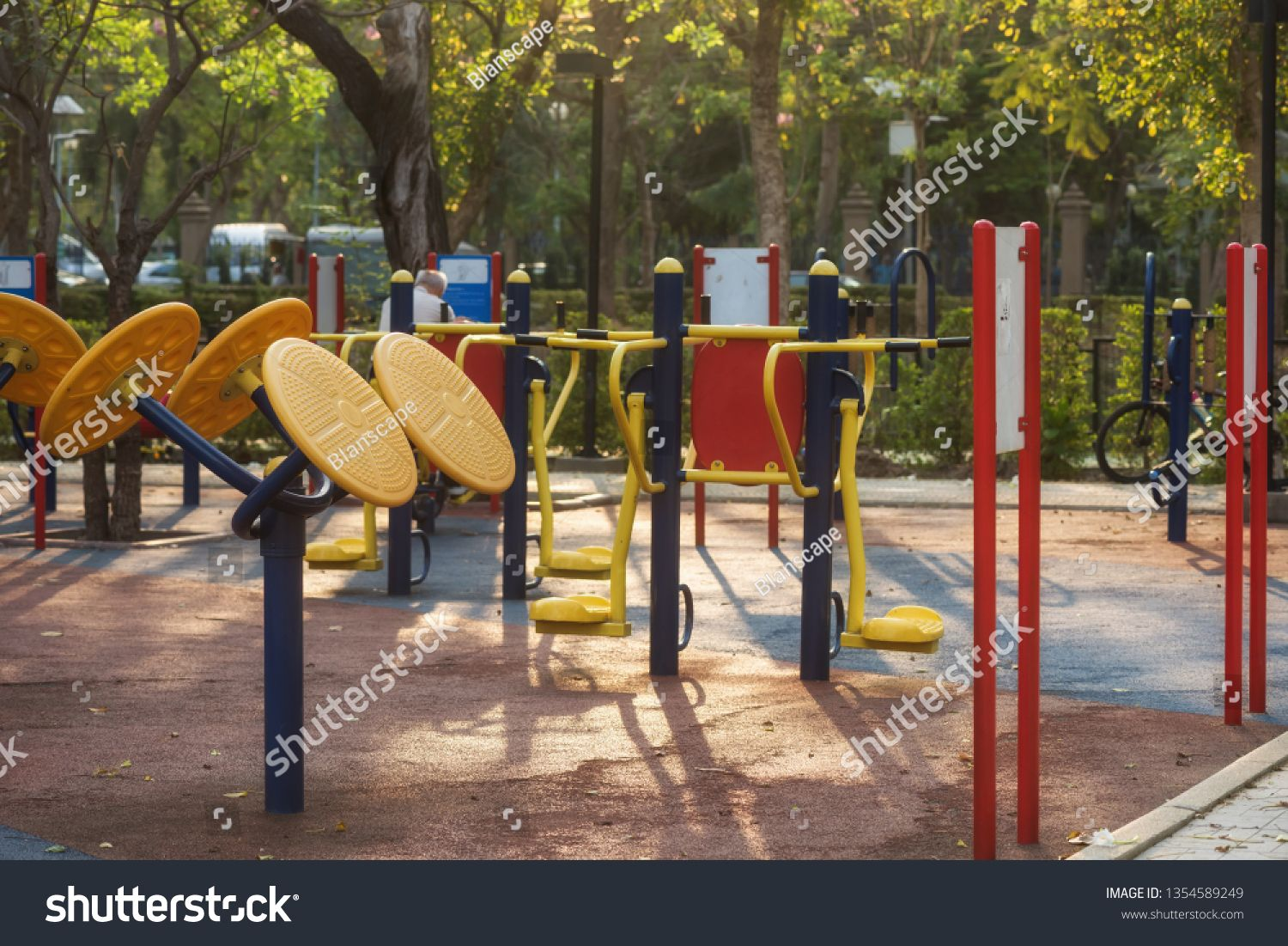 Outdoor Sport Equipments In Public Park At Sunrise With Light And