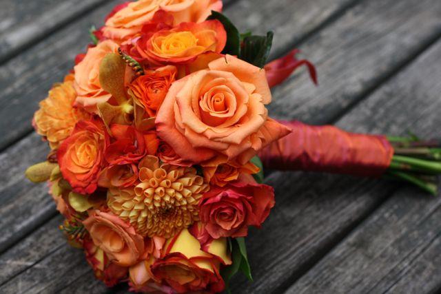 circus roses, orange unique roses, milva roses, crocosmia, orange orchids and a few dahlias