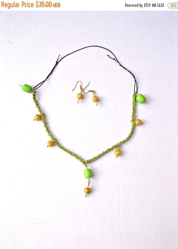 d665db603774d Choker Beaded Necklace with round Green and Gold Beads Dangling on a ...
