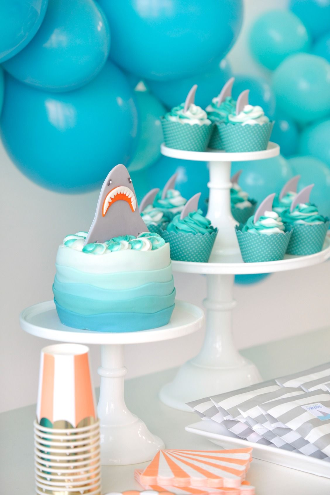 This ombre blue shark attack birthday cake is awesome. Decorated ...