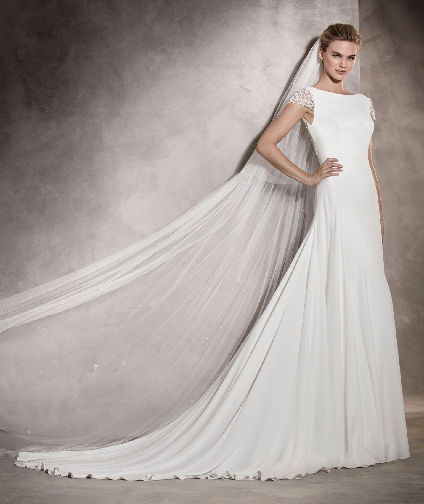 Ana — расклешенное свадебное платье из крепа и тюля, украшенное ...