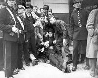 The Battle of Cable Street 1936. Attending to one of the injured.
