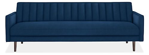 Inspired by mid-century design, our Goodwin sofa gives a nod to the past but provides comfort and sophistication for today. The channeled back sets this elegant sofa apart and comfortably supports you at a gentle angle. The attached bench seat cushion offers an upright feel and a tidy, streamlined appearance. Goodwin is a statement sofa that bridges modern and classic style.