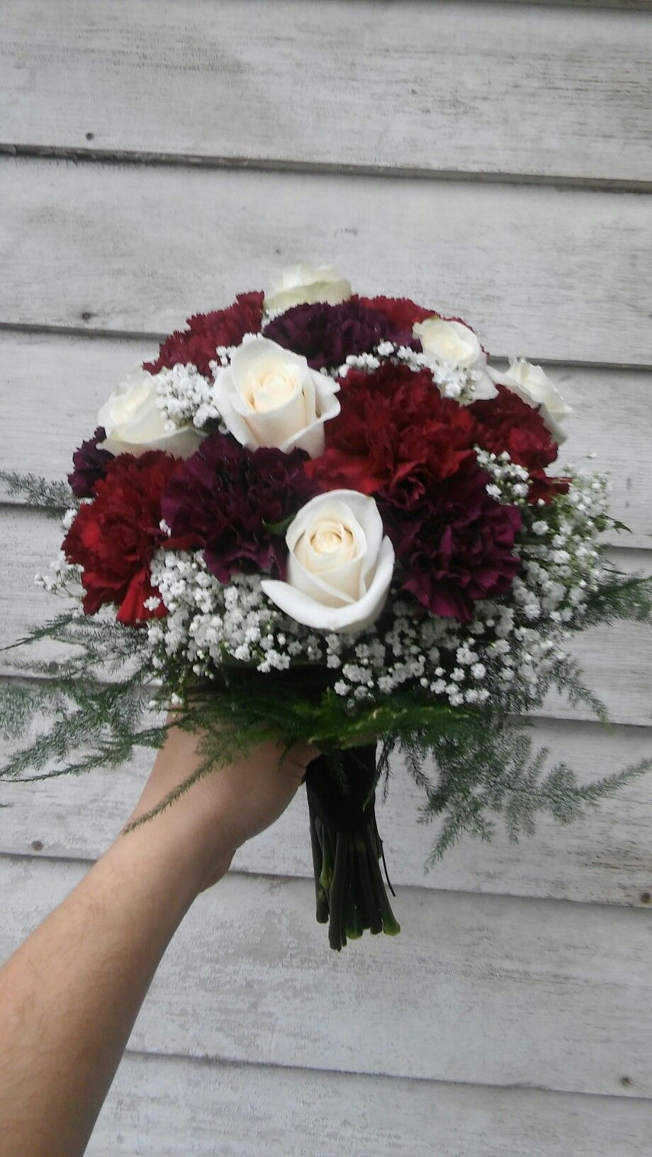 Rich Colored Bridal Bouquet Of Burgundy And Deep Purple Carnations Cream Roses Baby S Breath