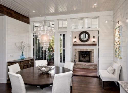 If you like the look of white but sometimes find it boring, painted paneling can be a perfect enhancement. The white is sleek, clean and shiny, while the grooves in the paneling add dimension and interest, creating a room with loads of personality.