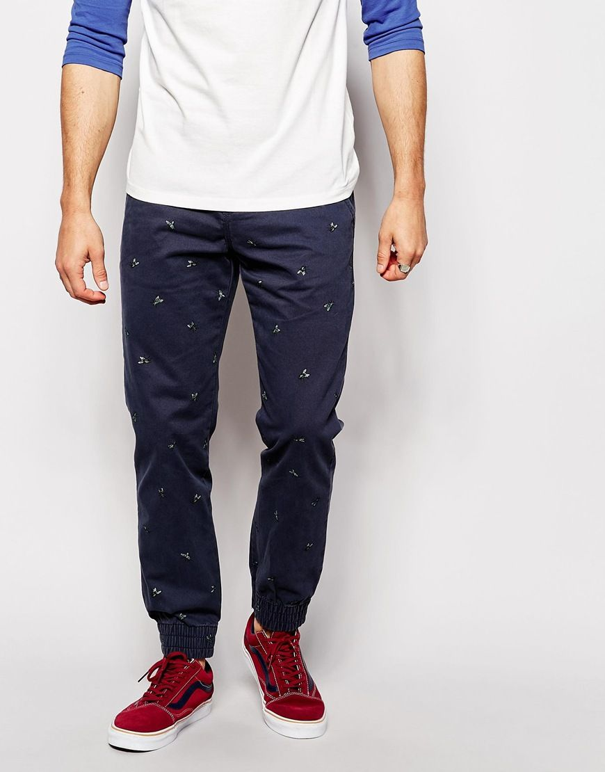 "Chinos by Vans Soft-touch cotton All-over-print Zip fly Side slant pockets Elasticated cuffs Slim fit - cut closely to the body Machine wash 100% Cotton Our model wears a 32""/81cm regular and is 185.5cm/6'1"" tall"