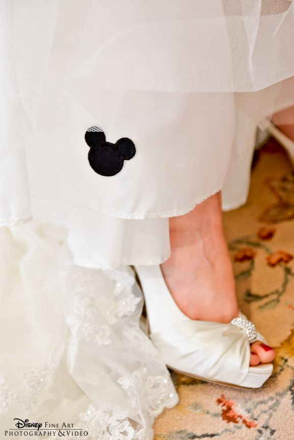 A Hint Of Mickey Mouse Embroidered On The Slip Of The Wedding Gown